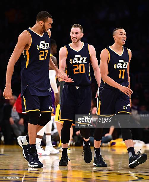 Gordon Hayward of the Utah Jazz celebrates his pass to Rudy Gobert with Dante Exum leading to a dunk after a timeout against the Los Angeles Lakers...