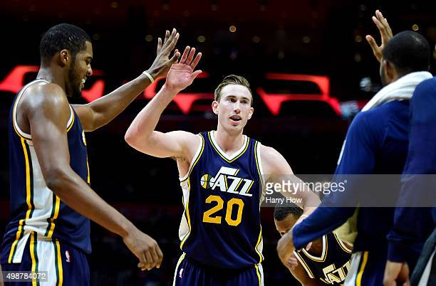 Gordon Hayward of the Utah Jazz celebrates his three point during a timeout with Derrick Favors and the bench at Staples Center on November 25 2015...