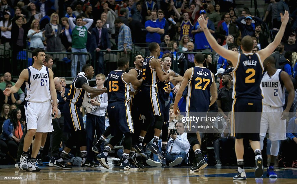 Gordon Hayward #20 of the Utah Jazz celebrates with his team after shooting the game winning basket against Zaza Pachulia #27 of the Dallas Mavericks in overtime at American Airlines Center on February 9, 2016 in Dallas, Texas. The Utah Jazz beat the Dallas Mavericks 121-119.