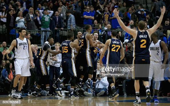 Gordon Hayward of the Utah Jazz celebrates with his team after shooting the game winning basket against Zaza Pachulia of the Dallas Mavericks in...