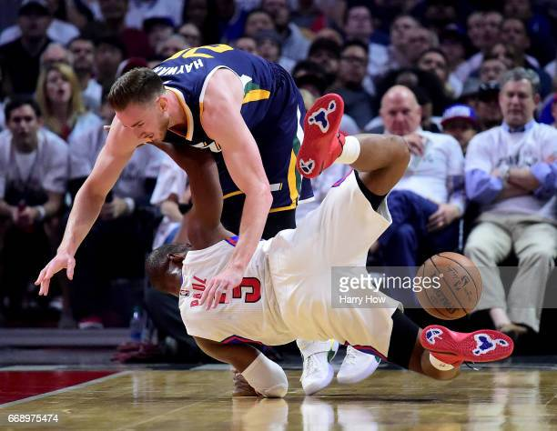 Gordon Hayward of the Utah Jazz collides with Chris Paul of the LA Clippers as he loses the ball during the first half at Staples Center on April 15...