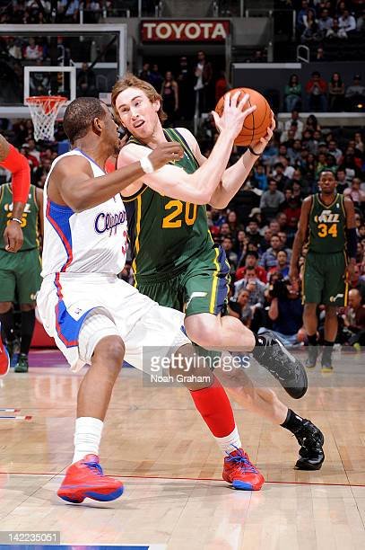 Gordon Hayward of the Utah Jazz dribbles against Chris Paul of the Los Angeles Clippers at Staples Center on March 31 2012 in Los Angeles California...