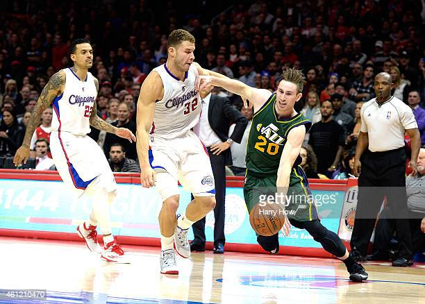 Gordon Hayward of the Utah Jazz dribbles away from Blake Griffin and Matt Barnes of the Los Angeles Clippers at Staples Center on December 29 2014 in...