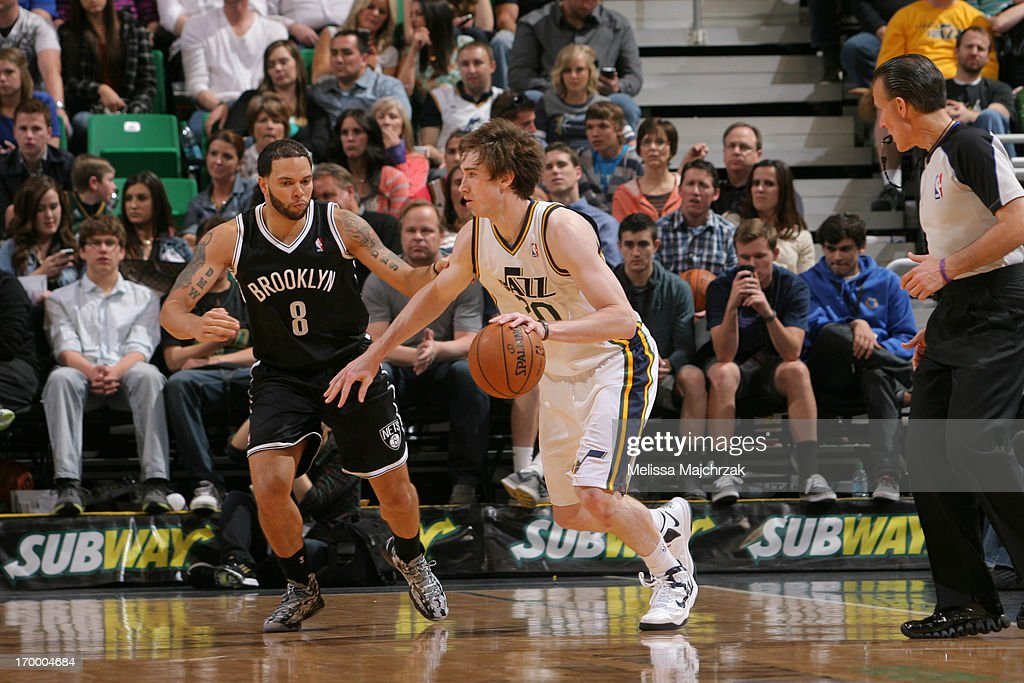<a gi-track='captionPersonalityLinkClicked' href=/galleries/search?phrase=Gordon+Hayward&family=editorial&specificpeople=5767271 ng-click='$event.stopPropagation()'>Gordon Hayward</a> #20 of the Utah Jazz drives against <a gi-track='captionPersonalityLinkClicked' href=/galleries/search?phrase=Deron+Williams&family=editorial&specificpeople=203215 ng-click='$event.stopPropagation()'>Deron Williams</a> #8 of the Brooklyn Nets at Energy Solutions Arena on March 30, 2013 in Salt Lake City, Utah.