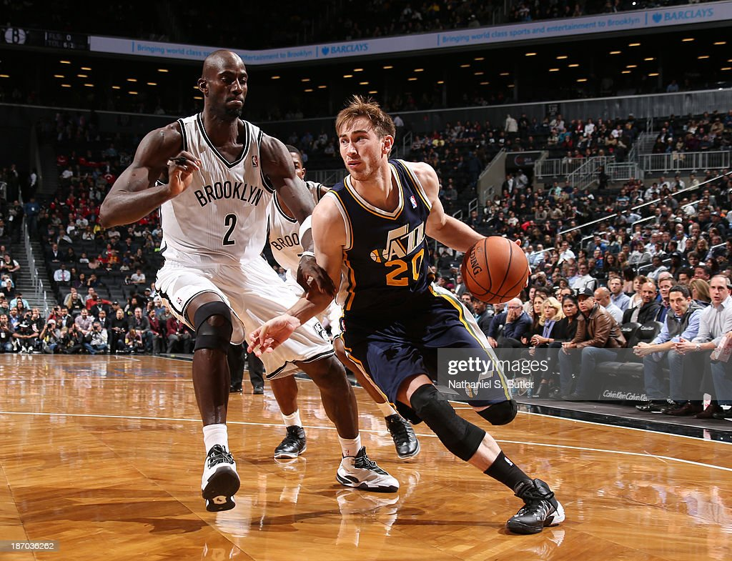 Gordon Hayward #20 of the Utah Jazz drives against Kevin Garnett #2 of the Brooklyn Nets during a game at Barclays Center on November 5, 2013 in the Brooklyn borough of New York City.