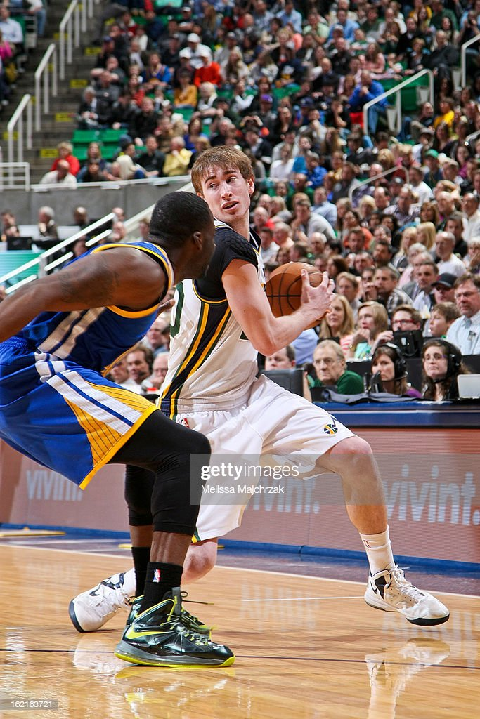 Gordon Hayward #20 of the Utah Jazz drives against the Golden State Warriors at Energy Solutions Arena on February 19, 2013 in Salt Lake City, Utah.