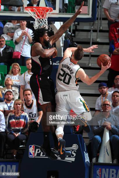 Gordon Hayward of the Utah Jazz drives to the basket against DeAndre Jordan of the Los Angeles Clippers in Game Six of the Western Conference...