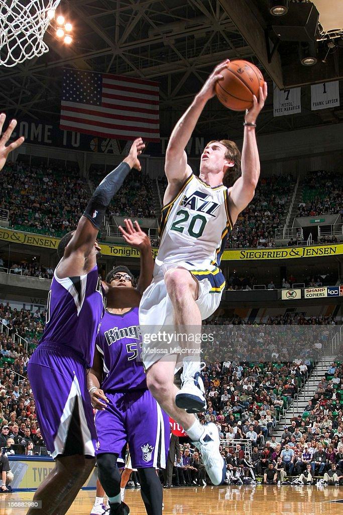 Gordon Hayward #20 of the Utah Jazz drives to the basket against James Johnson #52 of the Sacramento Kings at Energy Solutions Arena on November 23, 2012 in Salt Lake City, Utah.