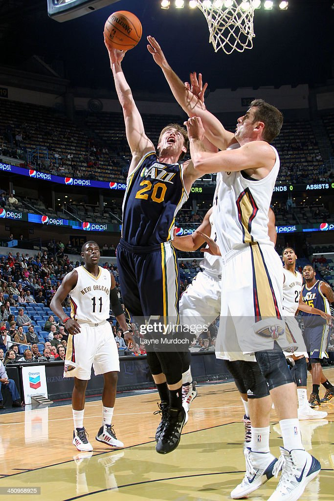 Gordon Hayward #20 of the Utah Jazz drives to the basket against Jason Smith #14 of the New Orleans Pelicans on November 20, 2013 at the New Orleans Arena in New Orleans, Louisiana.