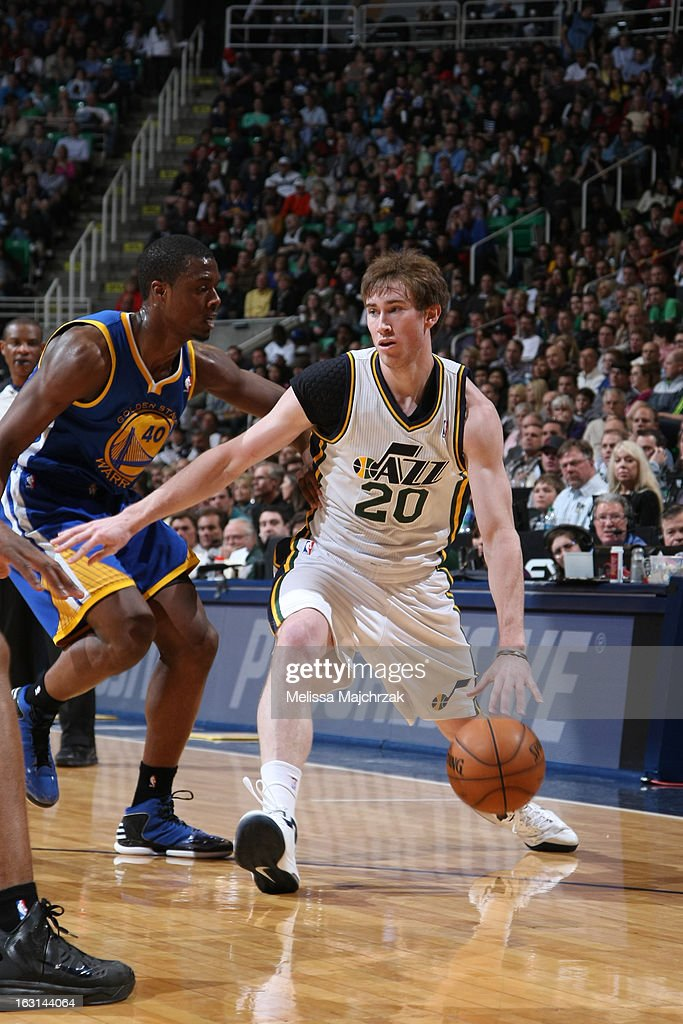 <a gi-track='captionPersonalityLinkClicked' href=/galleries/search?phrase=Gordon+Hayward&family=editorial&specificpeople=5767271 ng-click='$event.stopPropagation()'>Gordon Hayward</a> #20 of the Utah Jazz drives to the basket against the Golden State Warriors at Energy Solutions Arena on February 19, 2013 in Salt Lake City, Utah.