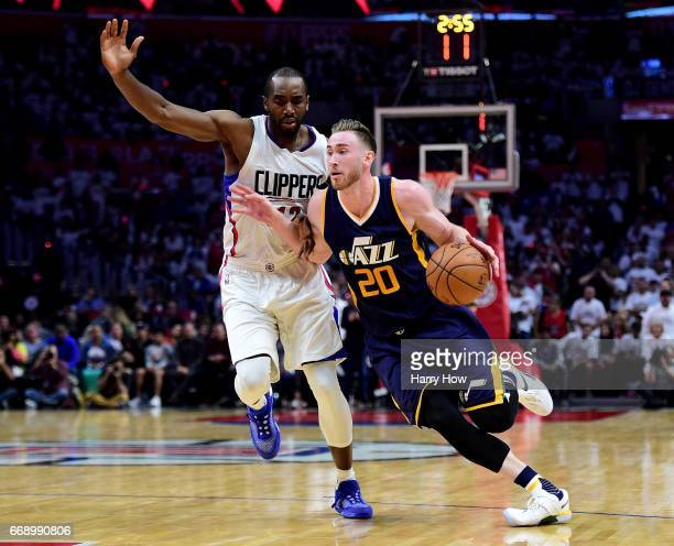 Gordon Hayward of the Utah Jazz drives to the basket ahead of Luc Mbah a Moute of the LA Clippers during a 9795 Jazz win at Staples Center on April...
