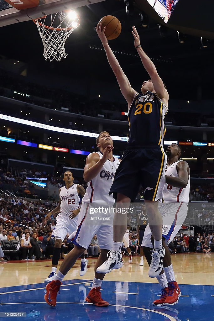 <a gi-track='captionPersonalityLinkClicked' href=/galleries/search?phrase=Gordon+Hayward&family=editorial&specificpeople=5767271 ng-click='$event.stopPropagation()'>Gordon Hayward</a> #20 of the Utah Jazz drives to the basket and scores past <a gi-track='captionPersonalityLinkClicked' href=/galleries/search?phrase=Blake+Griffin+-+Basketball+Player&family=editorial&specificpeople=4216010 ng-click='$event.stopPropagation()'>Blake Griffin</a> #32 and <a gi-track='captionPersonalityLinkClicked' href=/galleries/search?phrase=DeAndre+Jordan&family=editorial&specificpeople=4665718 ng-click='$event.stopPropagation()'>DeAndre Jordan</a> #6 of the Los Angeles Clippers during the second half of a preseason game at Staples Center on October 17, 2012 in Los Angeles, California. The Clippers defeated the Jazz 96-94.