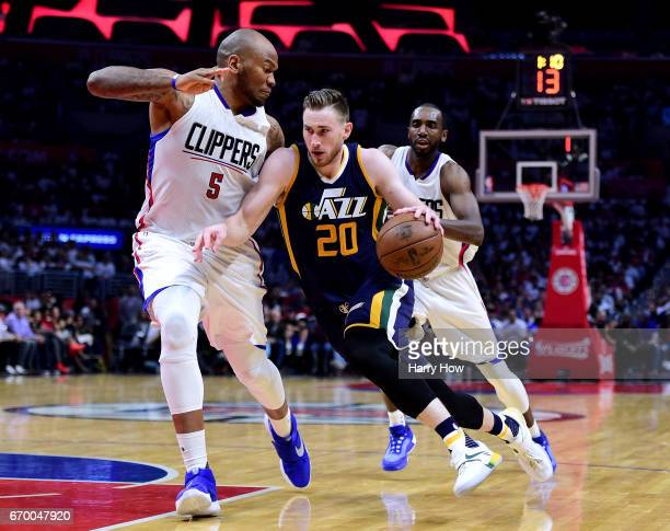 Gordon Hayward of the Utah Jazz drives to the basket on Marreese Speights and Luc Mbah a Moute of the LA Clippers during a 9991 Clippers win in Game...