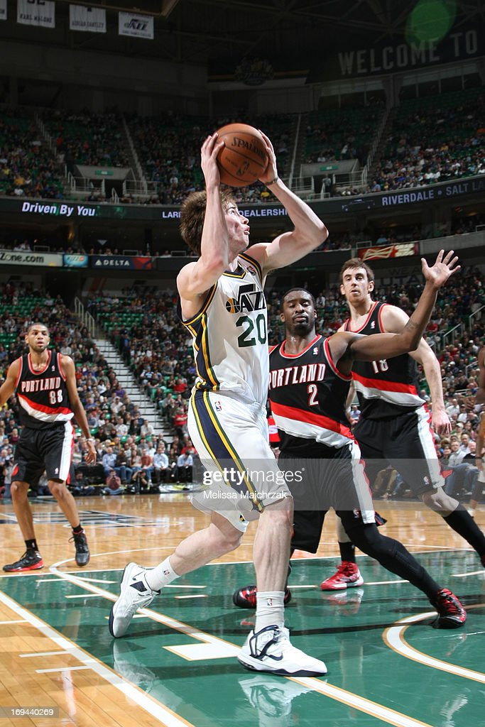 <a gi-track='captionPersonalityLinkClicked' href=/galleries/search?phrase=Gordon+Hayward&family=editorial&specificpeople=5767271 ng-click='$event.stopPropagation()'>Gordon Hayward</a> #20 of the Utah Jazz goes to the basket against <a gi-track='captionPersonalityLinkClicked' href=/galleries/search?phrase=Wesley+Matthews+-+Basketball+Player&family=editorial&specificpeople=804816 ng-click='$event.stopPropagation()'>Wesley Matthews</a> #2 of the Portland Trail Blazers at Energy Solutions Arena on April 1, 2013 in Salt Lake City, Utah.