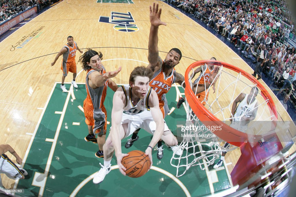 <a gi-track='captionPersonalityLinkClicked' href=/galleries/search?phrase=Gordon+Hayward&family=editorial&specificpeople=5767271 ng-click='$event.stopPropagation()'>Gordon Hayward</a> #20 of the Utah Jazz goes to the basket past <a gi-track='captionPersonalityLinkClicked' href=/galleries/search?phrase=Luis+Scola&family=editorial&specificpeople=2464749 ng-click='$event.stopPropagation()'>Luis Scola</a> #14 and <a gi-track='captionPersonalityLinkClicked' href=/galleries/search?phrase=Markieff+Morris&family=editorial&specificpeople=5293881 ng-click='$event.stopPropagation()'>Markieff Morris</a> #11 of the Phoenix Suns at Energy Solutions Arena on November 10, 2012 in Salt Lake City, Utah.