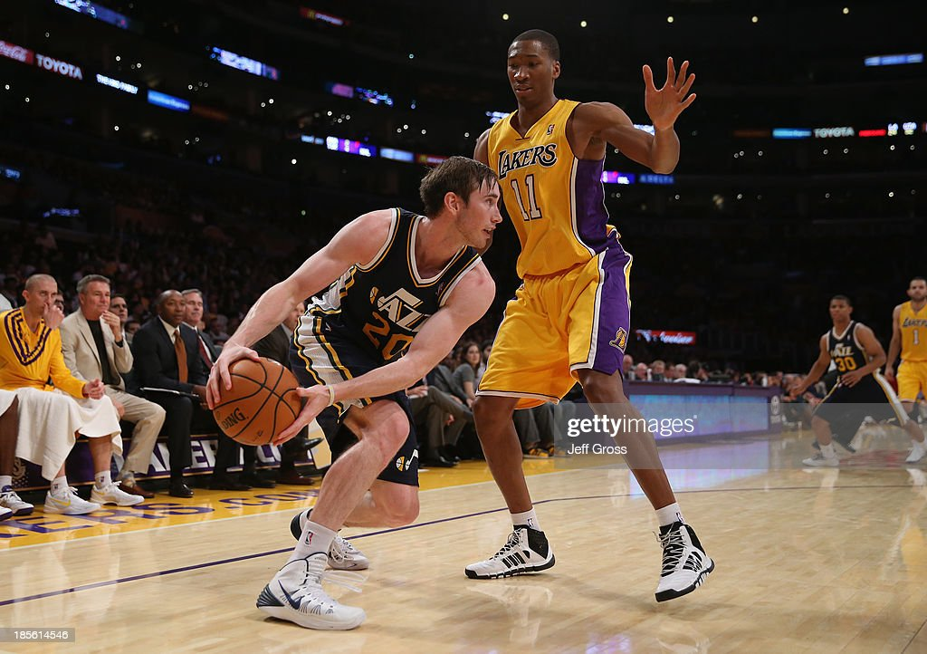 <a gi-track='captionPersonalityLinkClicked' href=/galleries/search?phrase=Gordon+Hayward&family=editorial&specificpeople=5767271 ng-click='$event.stopPropagation()'>Gordon Hayward</a> #20 of the Utah Jazz is defended by <a gi-track='captionPersonalityLinkClicked' href=/galleries/search?phrase=Wesley+Johnson+-+Basketball+Player&family=editorial&specificpeople=4184049 ng-click='$event.stopPropagation()'>Wesley Johnson</a> #11 of the Los Angeles Lakers in the second half at Staples Center on October 22, 2013 in Los Angeles, California. The Lakers defeated the Jazz 108-94.
