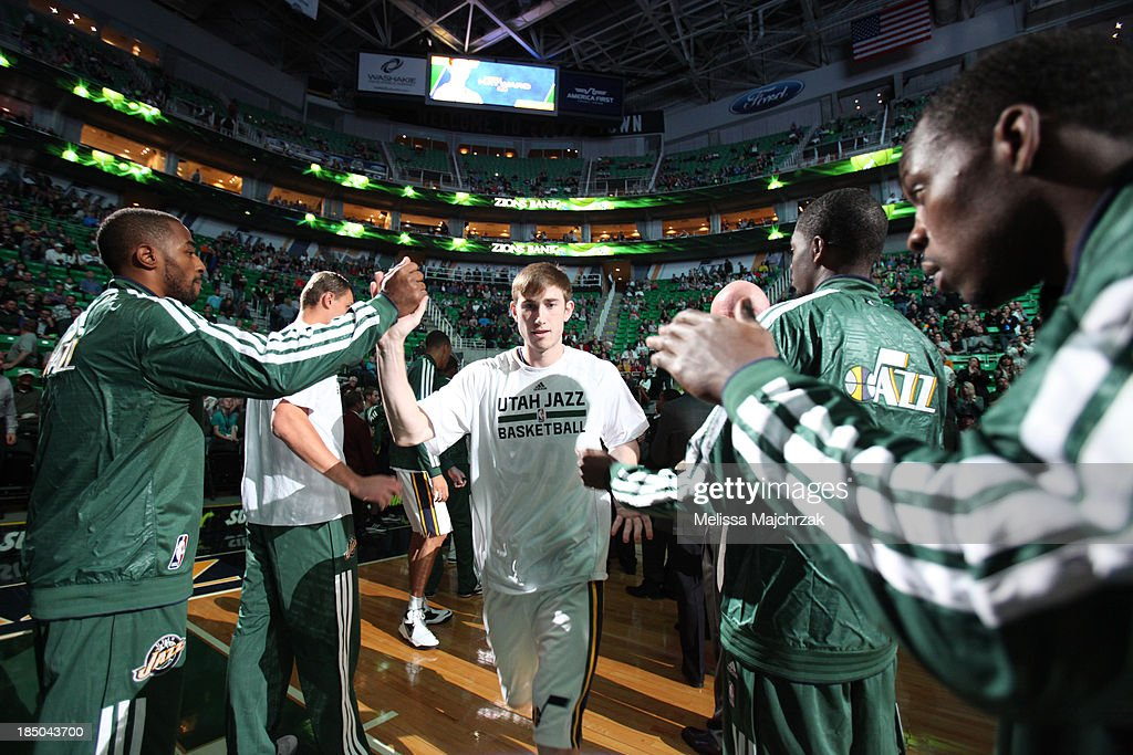 <a gi-track='captionPersonalityLinkClicked' href=/galleries/search?phrase=Gordon+Hayward&family=editorial&specificpeople=5767271 ng-click='$event.stopPropagation()'>Gordon Hayward</a> #20 of the Utah Jazz is welcomed to the court by teammates before their matchup against the Portland Trail Blazers at Energy Solutions Arena on October 16, 2013 in Salt Lake City, Utah.