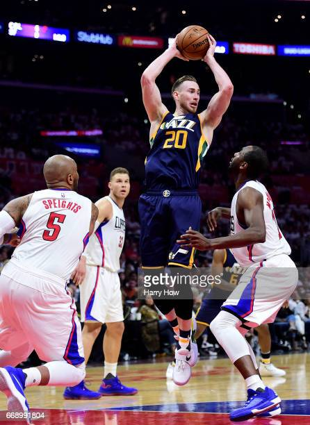 Gordon Hayward of the Utah Jazz looks to pass over Luc Mbah a Moute and Marreese Speights of the LA Clippers during a 9795 Jazz win at Staples Center...