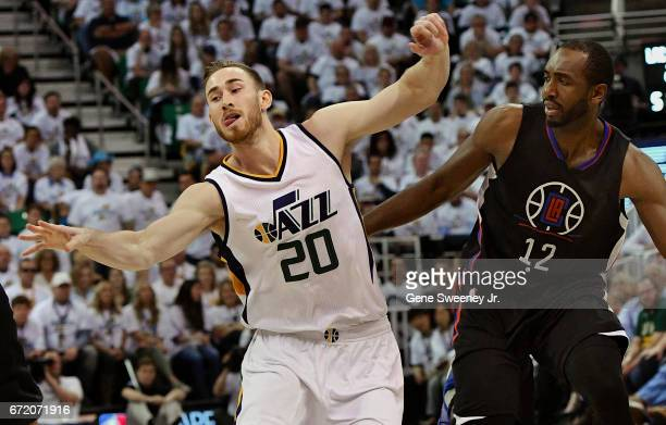Gordon Hayward of the Utah Jazz loses his balance while being defended by Luc Mbah a Moute of the Los Angeles Clippers in the first half in Game Four...