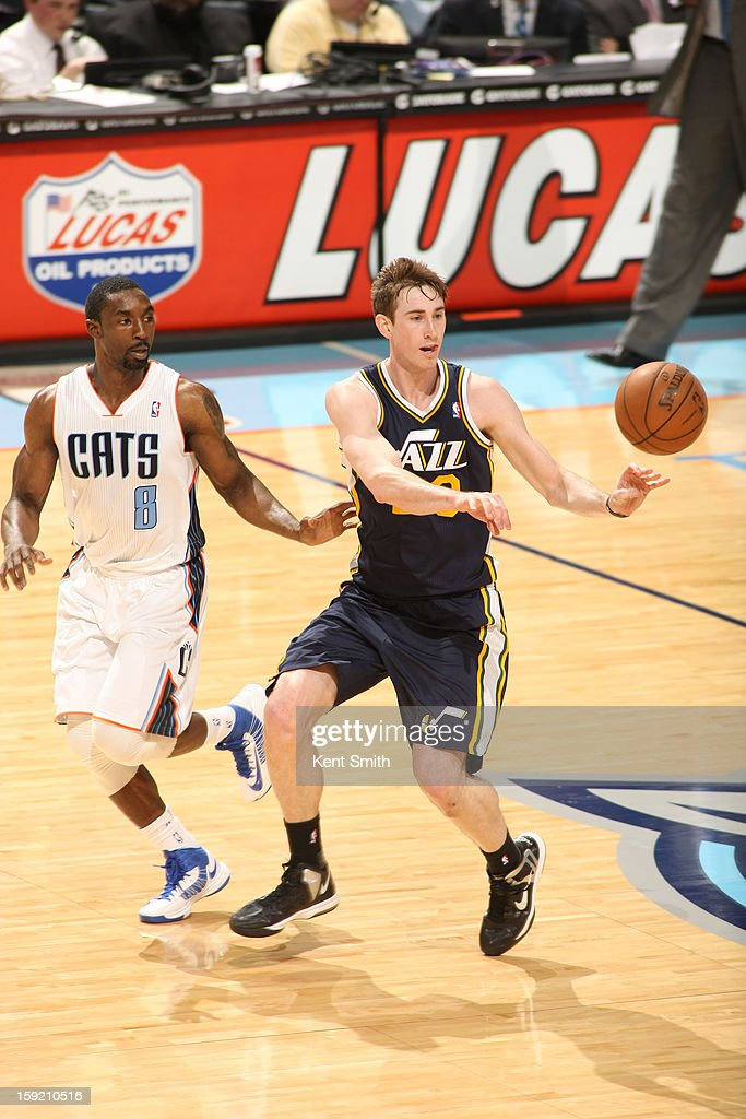 Gordon Hayward #20 of the Utah Jazz passes the ball against Ben Gordon #8 of the Charlotte Bobcats at the Time Warner Cable Arena on January 9, 2013 in Charlotte, North Carolina.