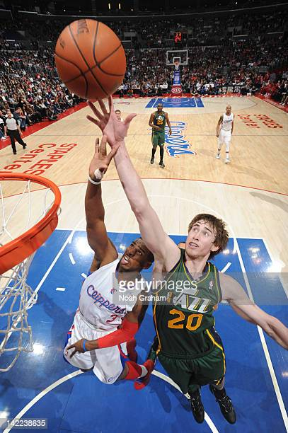 Gordon Hayward of the Utah Jazz reaches for a rebound against Chris Paul of the Los Angeles Clippers at Staples Center on March 31 2012 in Los...