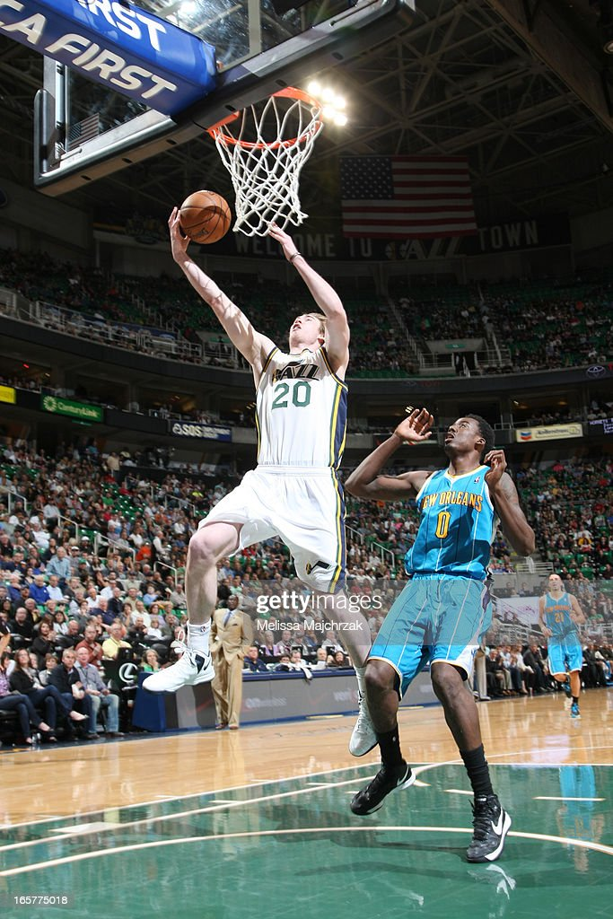 Gordon Hayward #20 of the Utah Jazz shoots a layup against Al-Farouq Aminu #0 of the New Orleans Hornets at Energy Solutions Arena on April 5, 2013 in Salt Lake City, Utah.