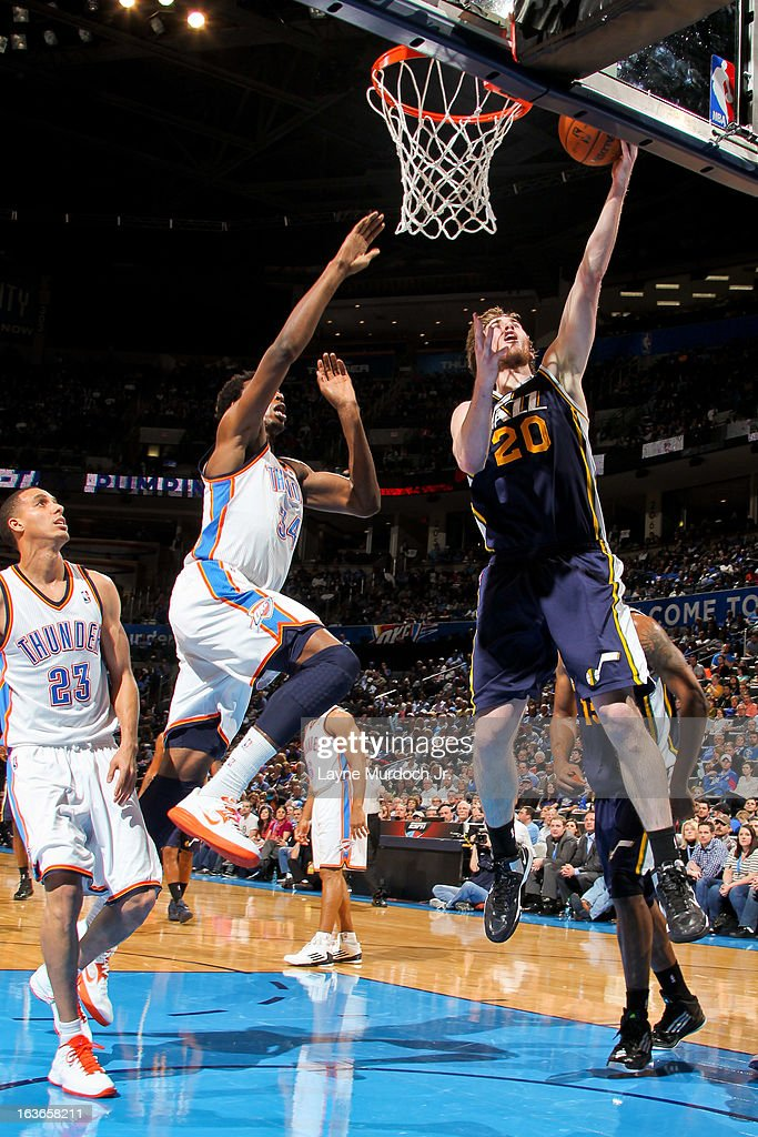 Gordon Hayward #20 of the Utah Jazz shoots a layup against Hasheem Thabeet #34 of the Oklahoma City Thunder on March 13, 2013 at the Chesapeake Energy Arena in Oklahoma City, Oklahoma.