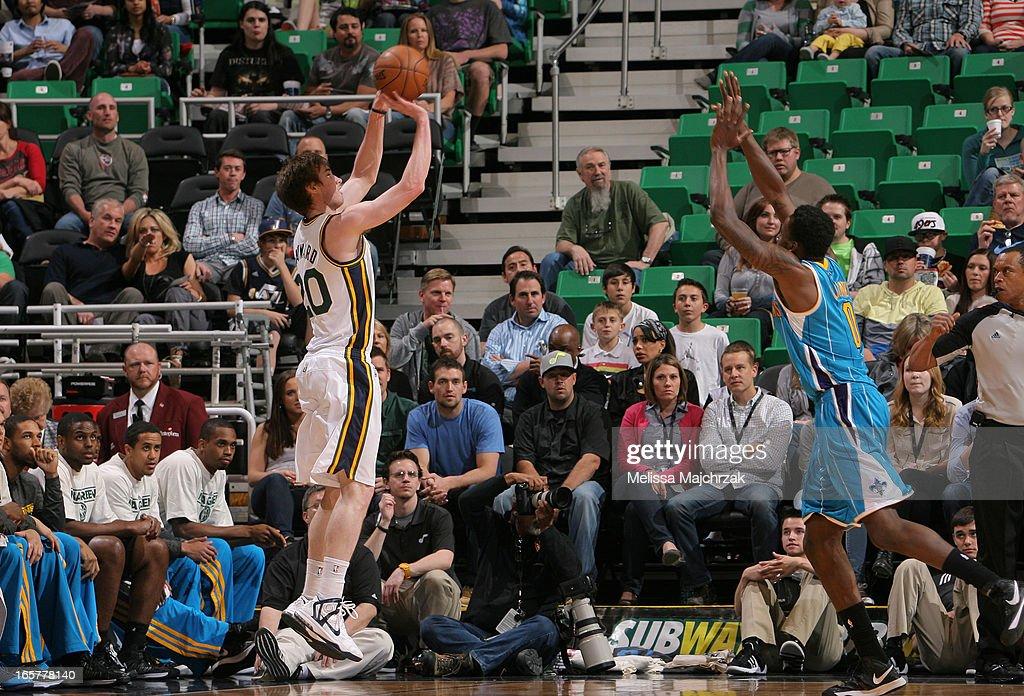 Gordon Hayward #20 of the Utah Jazz shoots against Al-Farouq Aminu #0 of the New Orleans Hornets at Energy Solutions Arena on April 5, 2013 in Salt Lake City, Utah.