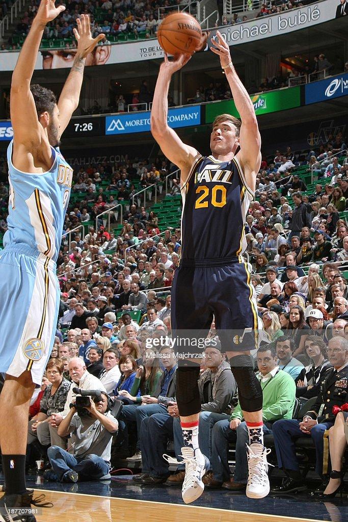 Gordon Hayward #20 of the Utah Jazz shoots against Evan Fourinier #94 of the Denver Nuggets at EnergySolutions Arena on November 11, 2013 in Salt Lake City, Utah.