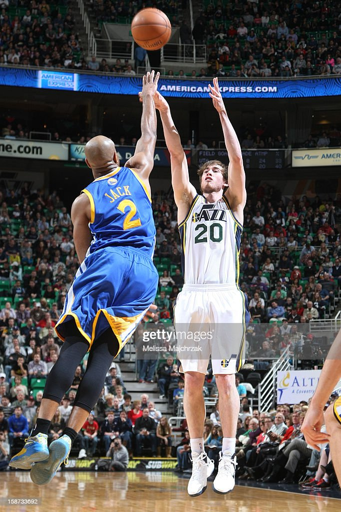 <a gi-track='captionPersonalityLinkClicked' href=/galleries/search?phrase=Gordon+Hayward&family=editorial&specificpeople=5767271 ng-click='$event.stopPropagation()'>Gordon Hayward</a> #20 of the Utah Jazz shoots against <a gi-track='captionPersonalityLinkClicked' href=/galleries/search?phrase=Jarrett+Jack&family=editorial&specificpeople=208109 ng-click='$event.stopPropagation()'>Jarrett Jack</a> #2 of the Golden State Warriors at Energy Solutions Arena on December 26, 2012 in Salt Lake City, Utah.