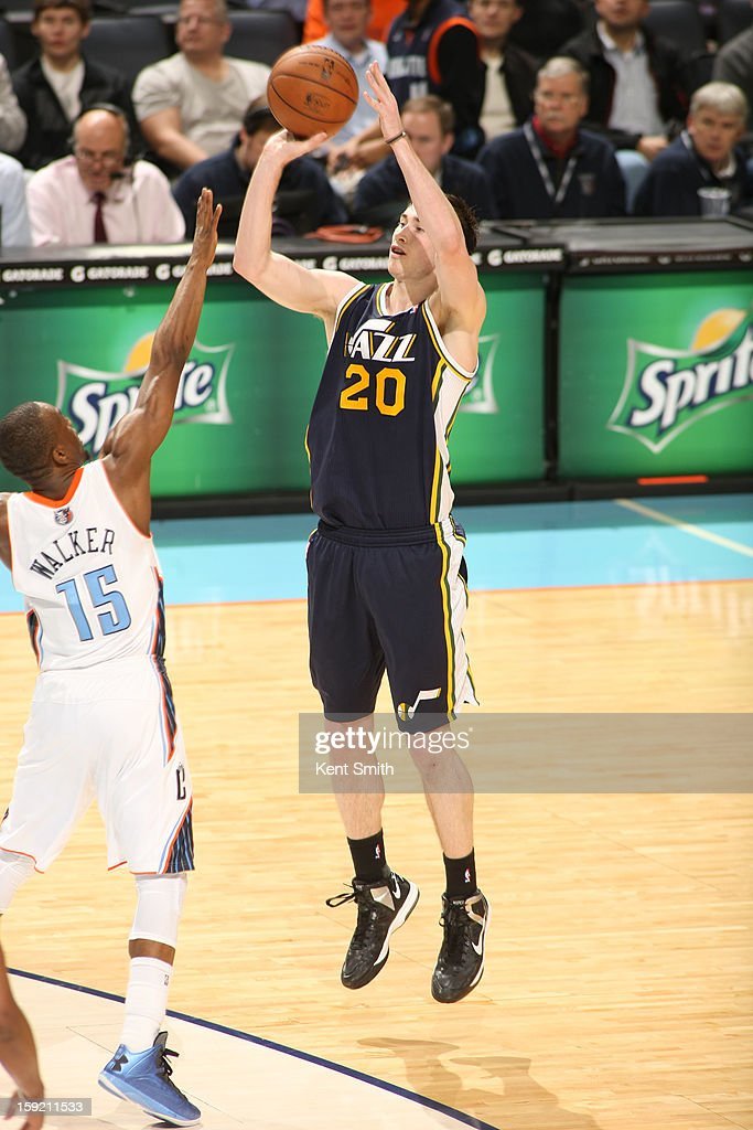 Gordon Hayward #20 of the Utah Jazz shoots against Kemba Walker #15 of the Charlotte Bobcats at the Time Warner Cable Arena on January 9, 2013 in Charlotte, North Carolina.