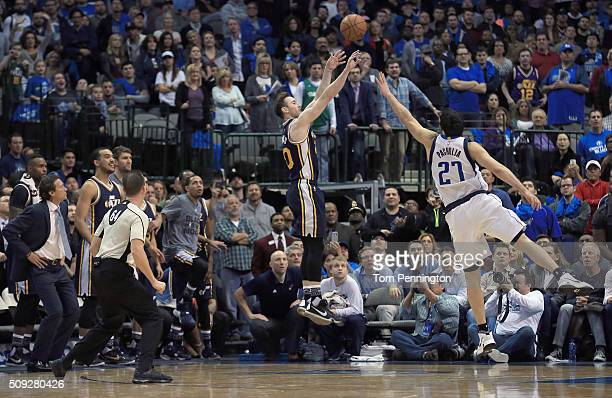 Gordon Hayward of the Utah Jazz shoots the game winning basket against Zaza Pachulia of the Dallas Mavericks in overtime at American Airlines Center...