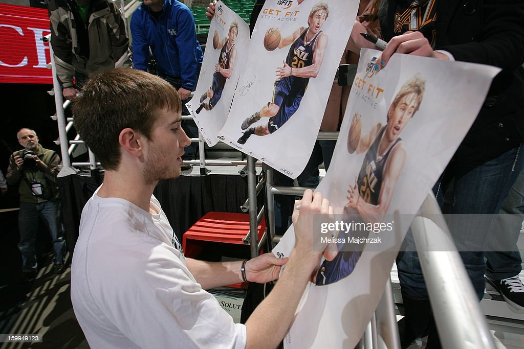 Gordon Hayward #20 of the Utah Jazz signs a poster of himself promoting a Jazz Fit program prior to the game against the Washington Wizards at Energy Solutions Arena on January 23, 2013 in Salt Lake City, Utah.