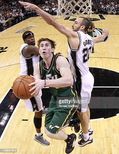 Gordon Hayward of the Utah Jazz takes a shot against Manu Ginobili of the San Antonio Spurs in Game Two of the Western Conference Quarterfinals of...