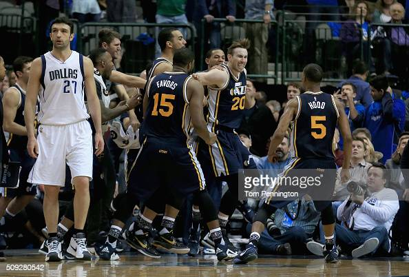 Gordon Hayward of the Utah Jazzcelebrates with his team after shooting the game winning basket against Zaza Pachulia of the Dallas Mavericks in...