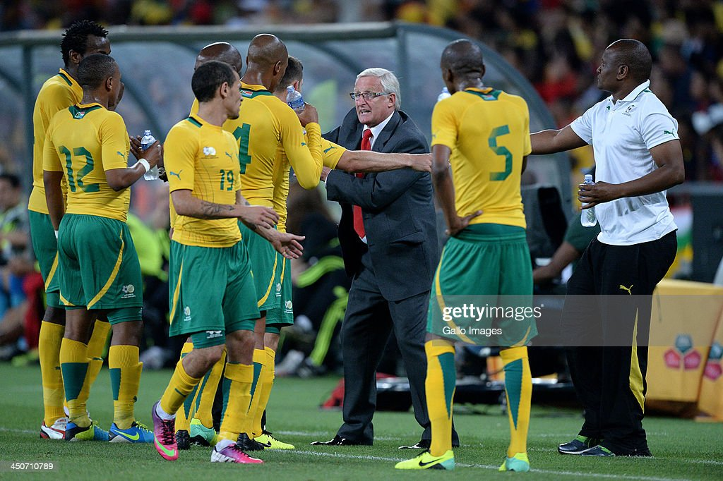 <a gi-track='captionPersonalityLinkClicked' href=/galleries/search?phrase=Gordon+Igesund&family=editorial&specificpeople=3647587 ng-click='$event.stopPropagation()'>Gordon Igesund</a> of South Africa congratulates his players at the final whistle during the International friendly match between South Africa and Spain at Soccer City Stadium on November 19, 2013 in Johannesburg, South Africa.