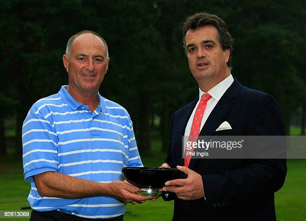 Gordon J Brand of England receives the trophy from His Grace The Duke of Bedford after the final round of the Travis Perkins plc Senior Masters...