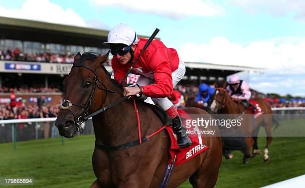 Gordon Lord Byron ridden by Johnny Murtagh wins The Betfred Sprint Cup held at Haydock Racecourse on September 7 2013 in Haydock England