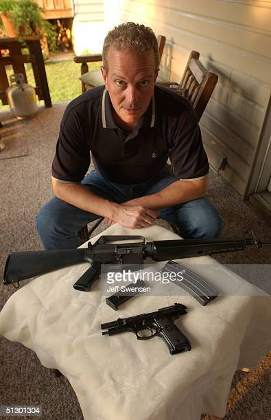 Gordon Lukus a firearms instructor and gun owner displays two bullet clips now permitted for sale following the expiration of the semiautomatic...