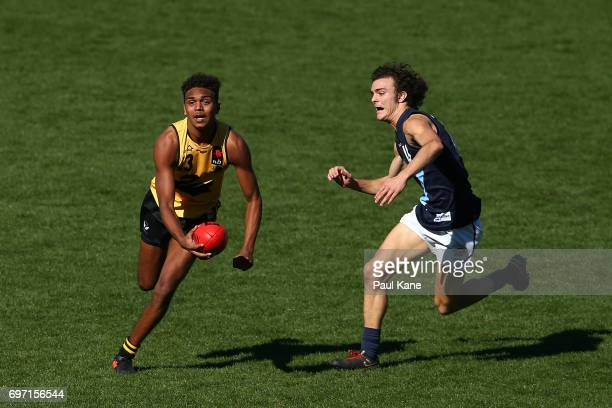 Gordon Narrier of Western Australia looks to handball during the U18 Championships match between Western Australia and Victoria Metro at Domain...