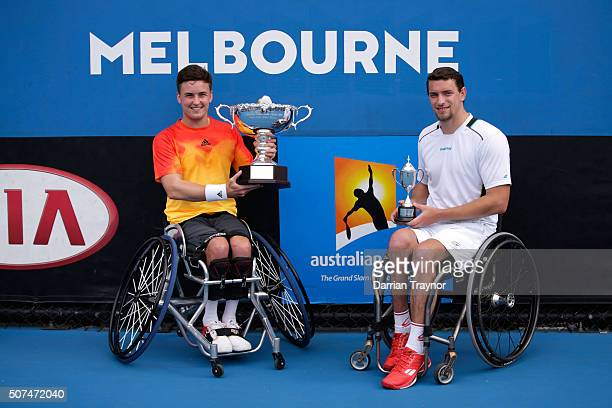 Gordon Reid of Great Britain and Joachim Gerard of Belgium pose with their trophies after the Men's Wheelchair Singles Final during the Australian...