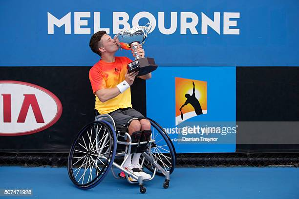 Gordon Reid of Great Britain kisses the championship trophy after winning the Men's Wheelchair Singles Final match against Joachim Gerard of Belgium...