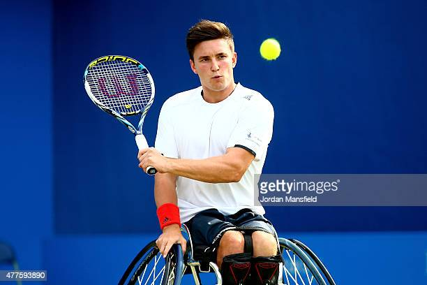 Gordon Reid of Great Britain partnering Marc McCarroll of Great Britain plays a backhand in the Men's Doubles Wheelchair Exhibtion Match against...