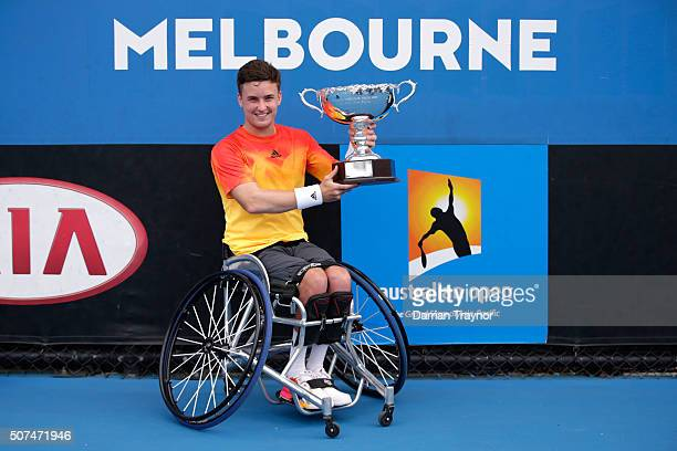 Gordon Reid of Great Britain poses with the championship trophy after winning the Men's Wheelchair Singles Final match against Joachim Gerard of...