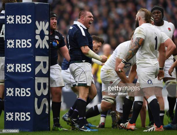 Gordon Reid of Scotland celebrates scoring his sides first try during the RBS Six Nations match between England and Scotland at Twickenham Stadium on...