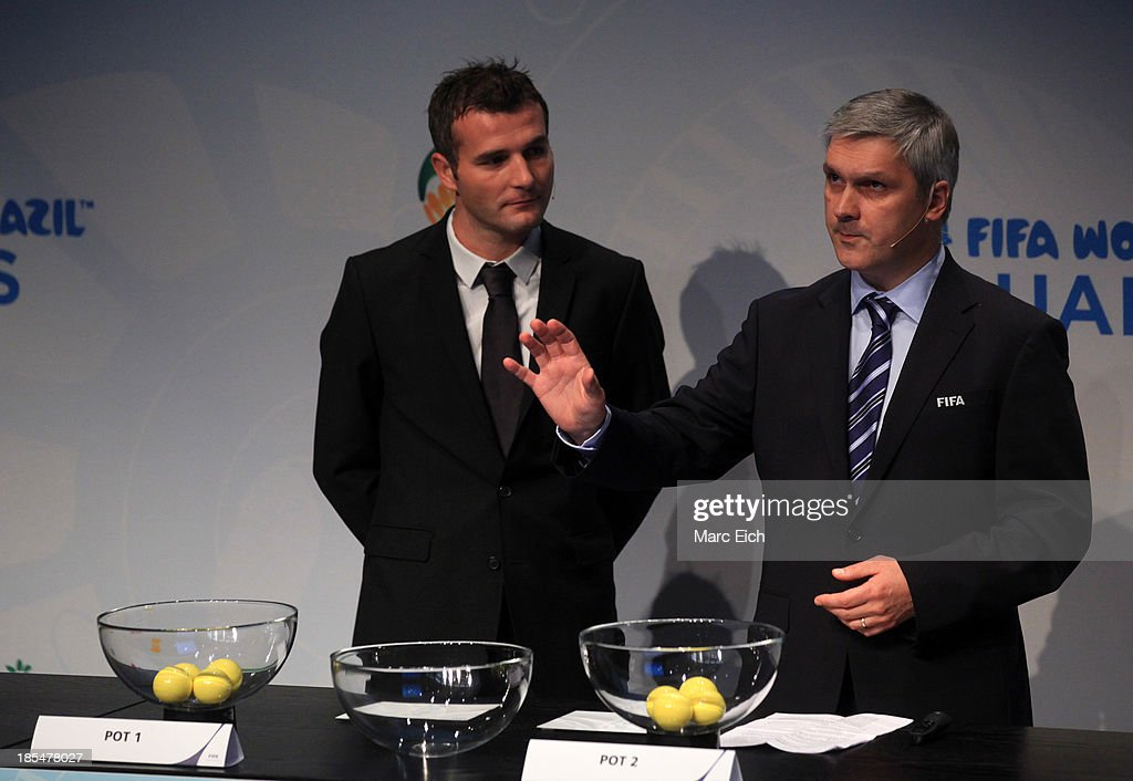 Gordon Savic (R), head of FIFA World Cup Qualifiers, and <a gi-track='captionPersonalityLinkClicked' href=/galleries/search?phrase=Alexander+Frei&family=editorial&specificpeople=534543 ng-click='$event.stopPropagation()'>Alexander Frei</a> (L), former Swiss international, explain the procedure during the FIFA World Cup 2014 European Zone Play-Off Match Draw at the FIFA headquarter on October 21, 2013 in Zurich, Switzerland.