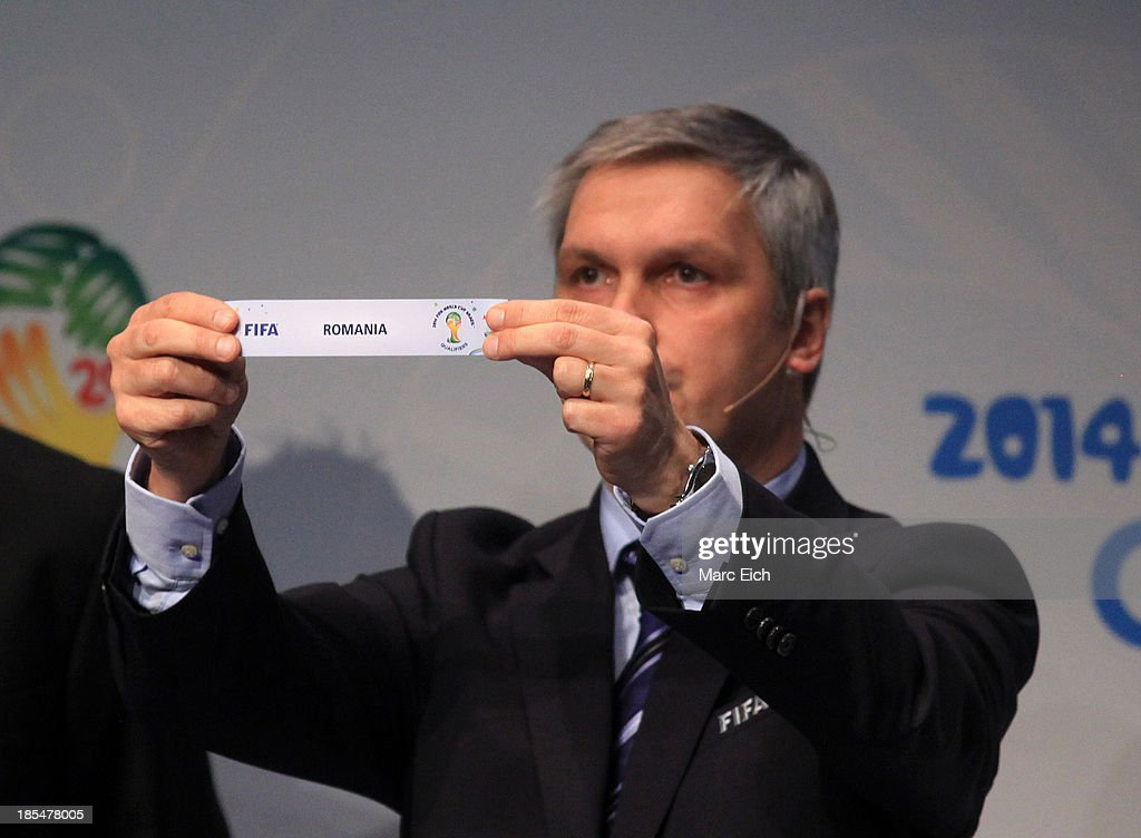 Gordon Savic, head of FIFA World Cup Qualifiers, shows the name of Romania during the FIFA World Cup 2014 European Zone Play-Off Match Draw at the FIFA headquarter on October 21, 2013 in Zurich, Switzerland.