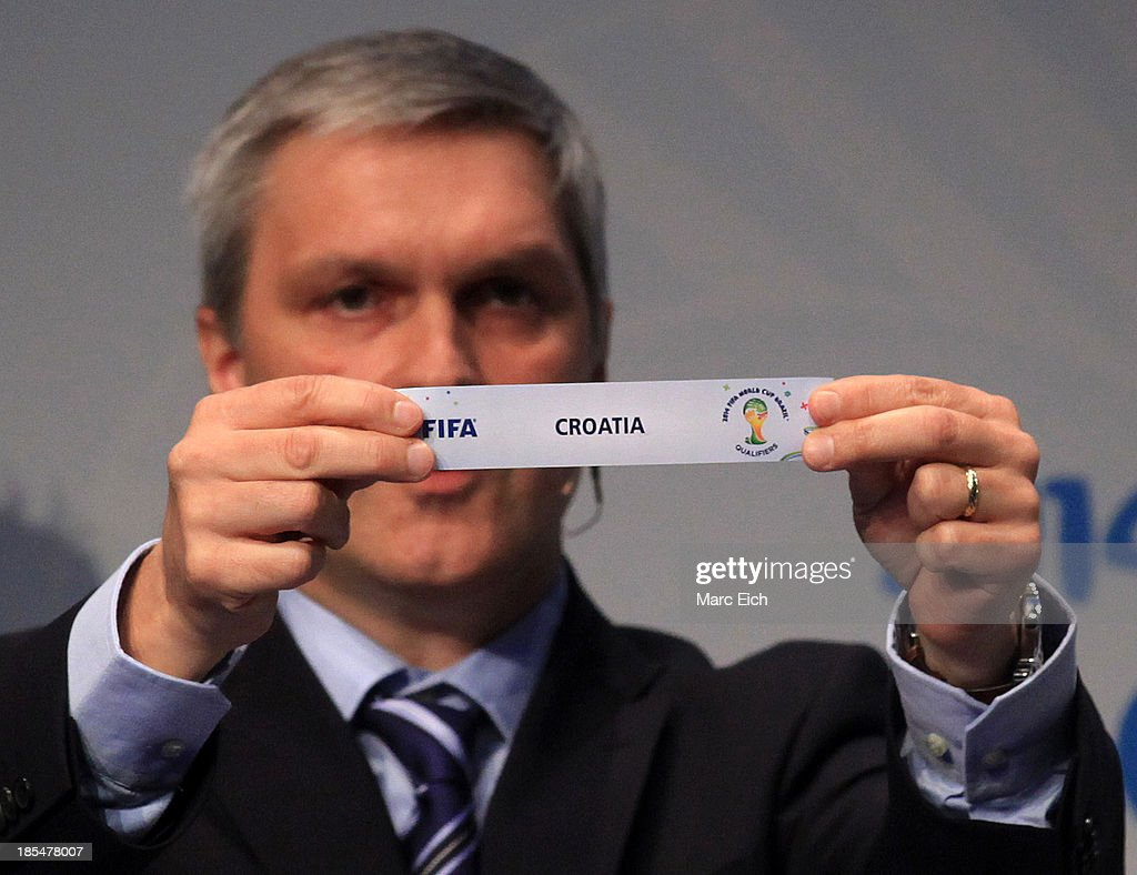 Gordon Savic, head of FIFA World Cup Qualifiers, shows the name of Croatia during the FIFA World Cup 2014 European Zone Play-Off Match Draw at the FIFA headquarter on October 21, 2013 in Zurich, Switzerland.