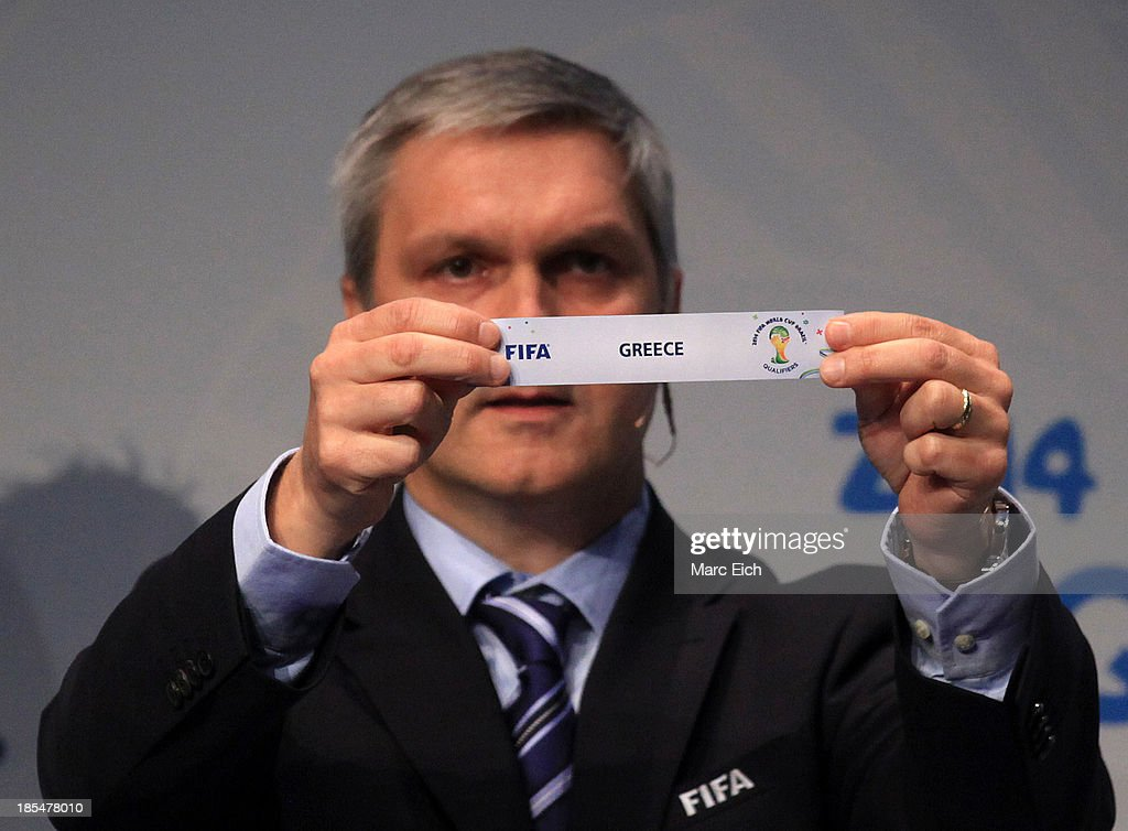 Gordon Savic, head of FIFA World Cup Qualifiers, shows the name of Greece during the FIFA World Cup 2014 European Zone Play-Off Match Draw at the FIFA headquarter on October 21, 2013 in Zurich, Switzerland.