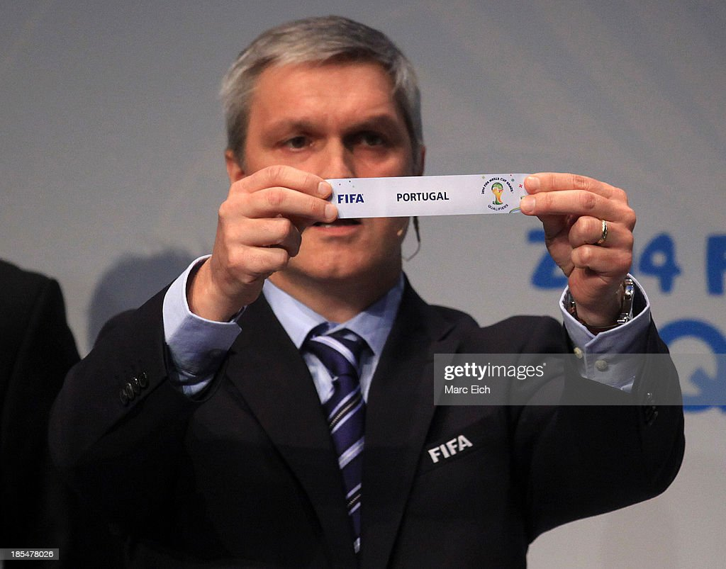 Gordon Savic, head of FIFA World Cup Qualifiers, shows the name of Portugal during the FIFA World Cup 2014 European Zone Play-Off Match Draw at the FIFA headquarter on October 21, 2013 in Zurich, Switzerland.